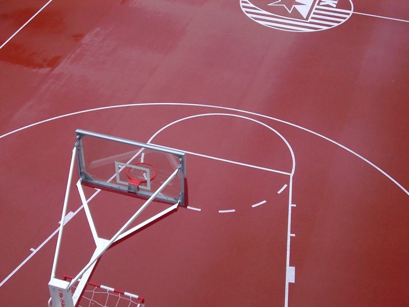 an outdoor red couloured baskteball colour viewed from above