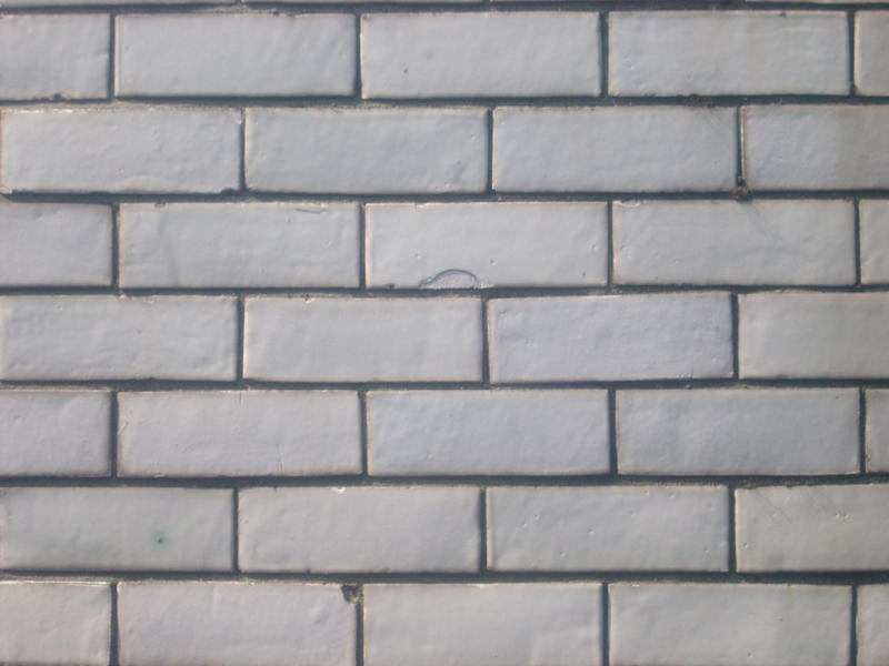 pattern of a white glazed brick wall