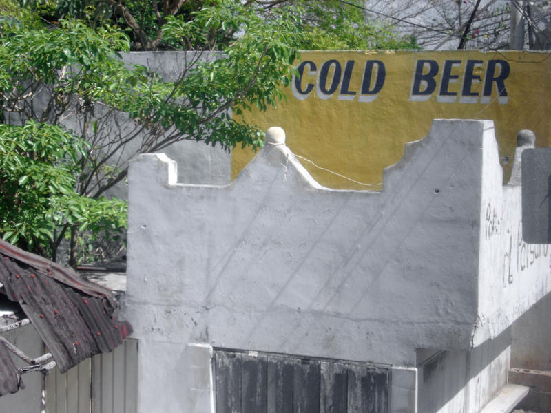 a building in mexico with a sign cold beer