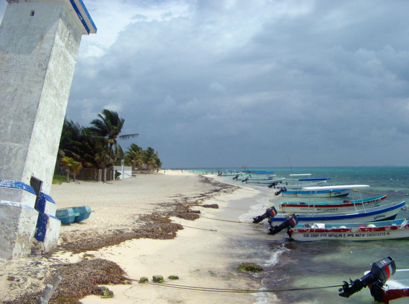 beach and fishing boats at Puerto Morelos, Quintana Roo, Mexico