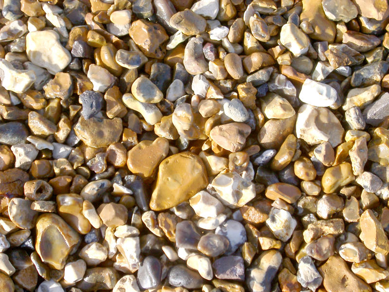 small shiney sea washed stones on a beach