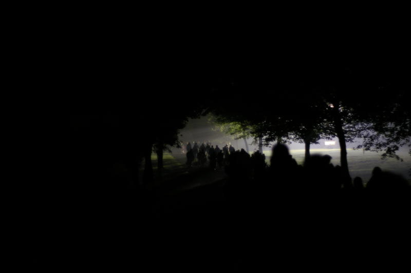 abstract and nightmare style photography, a line of people walking through a park