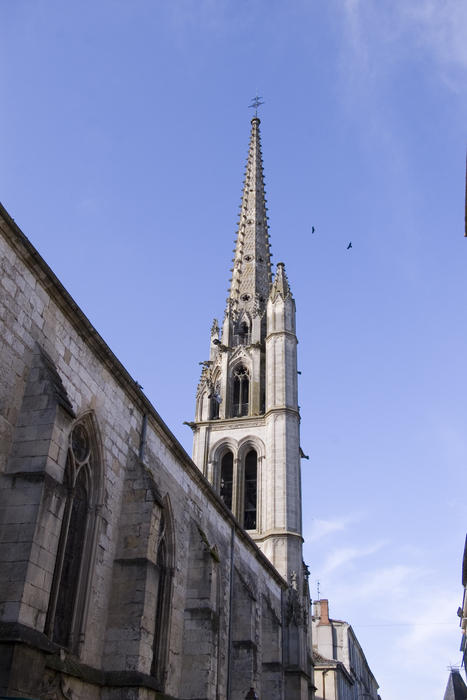 a french church tower with distinctive asymetric design
