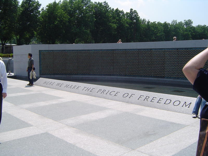 "world war two memorial, washington DC, ""Here we mark the price of freedom"", each gold star represents 100 americans who died"