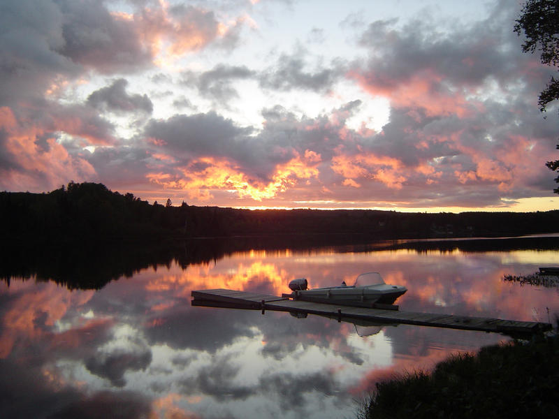 sunset over a lake in Algonquin provincial park, Ontario, Canada