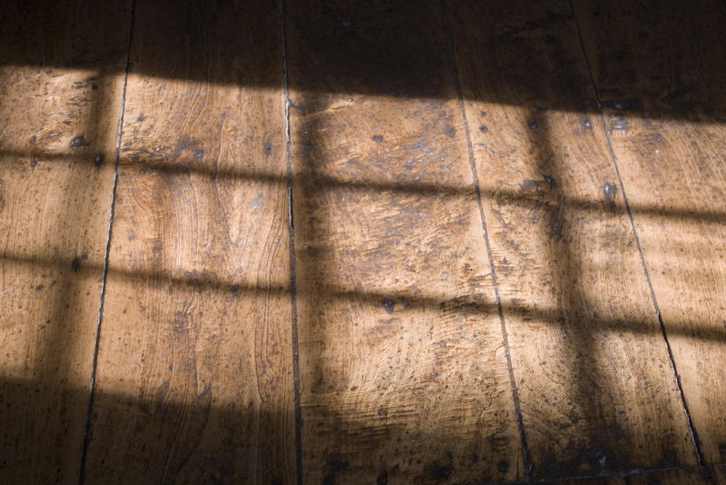pattern of window light on a traditional wooden floor