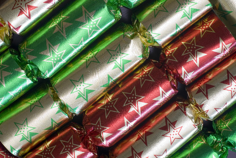 A line of colourful metallic foil christmas crackers