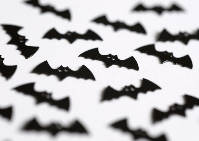 bat shaped halloween party decorations pictured with a narrow depth of field