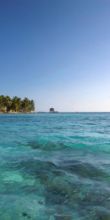 tropical paradise: tobacco caye, a tiny coral cay off the coast of Belize