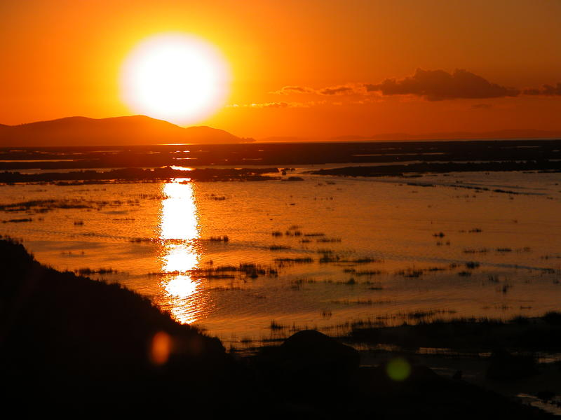 <p>Sunrise over Lake Titicaca in Peru</p>