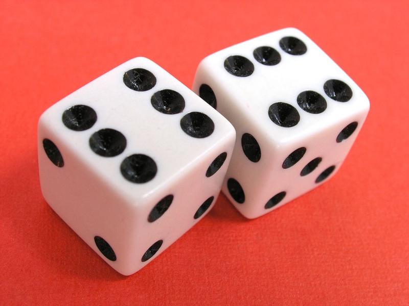 "<p>Dice showing sixes on red background. Larger high resolution image available <a target=""_blank"" href=""http://alexhd57.clustershot.com/photo763301"">here</a>.</p>Lucky Dice showing a pair of sixes."