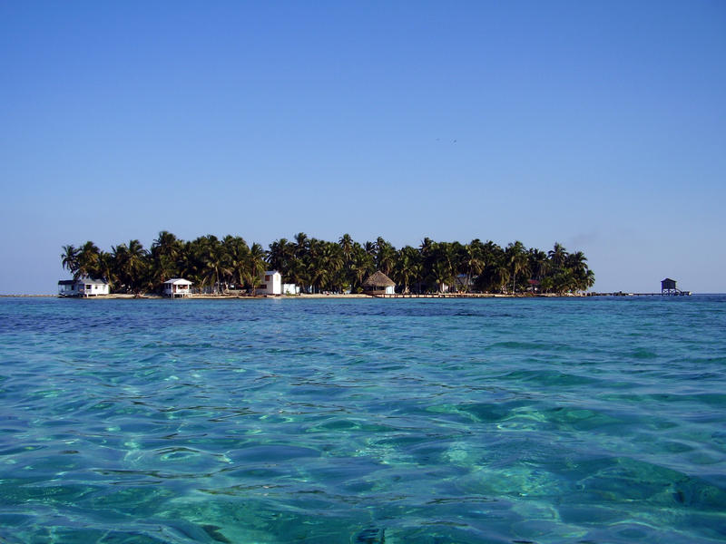 Tropical island paradise, tobacco caye a tiny coral island off the coast of Belize