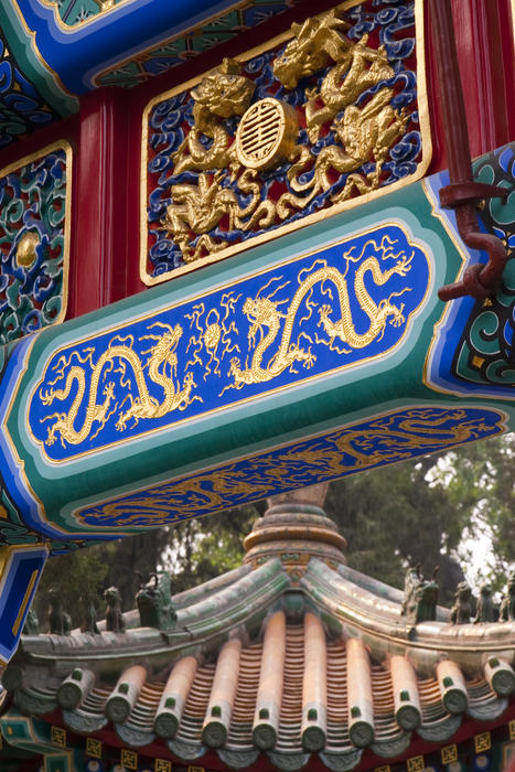 close up on the lucky gold decorations and paintings on a traditional chinese temple archway