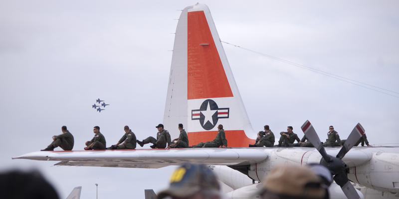 editorial use only : crew line up on the tailplane of a USCG hercules during an airshow