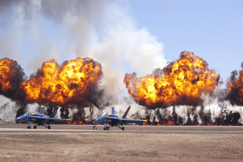 fire balls exploding during an airshow display