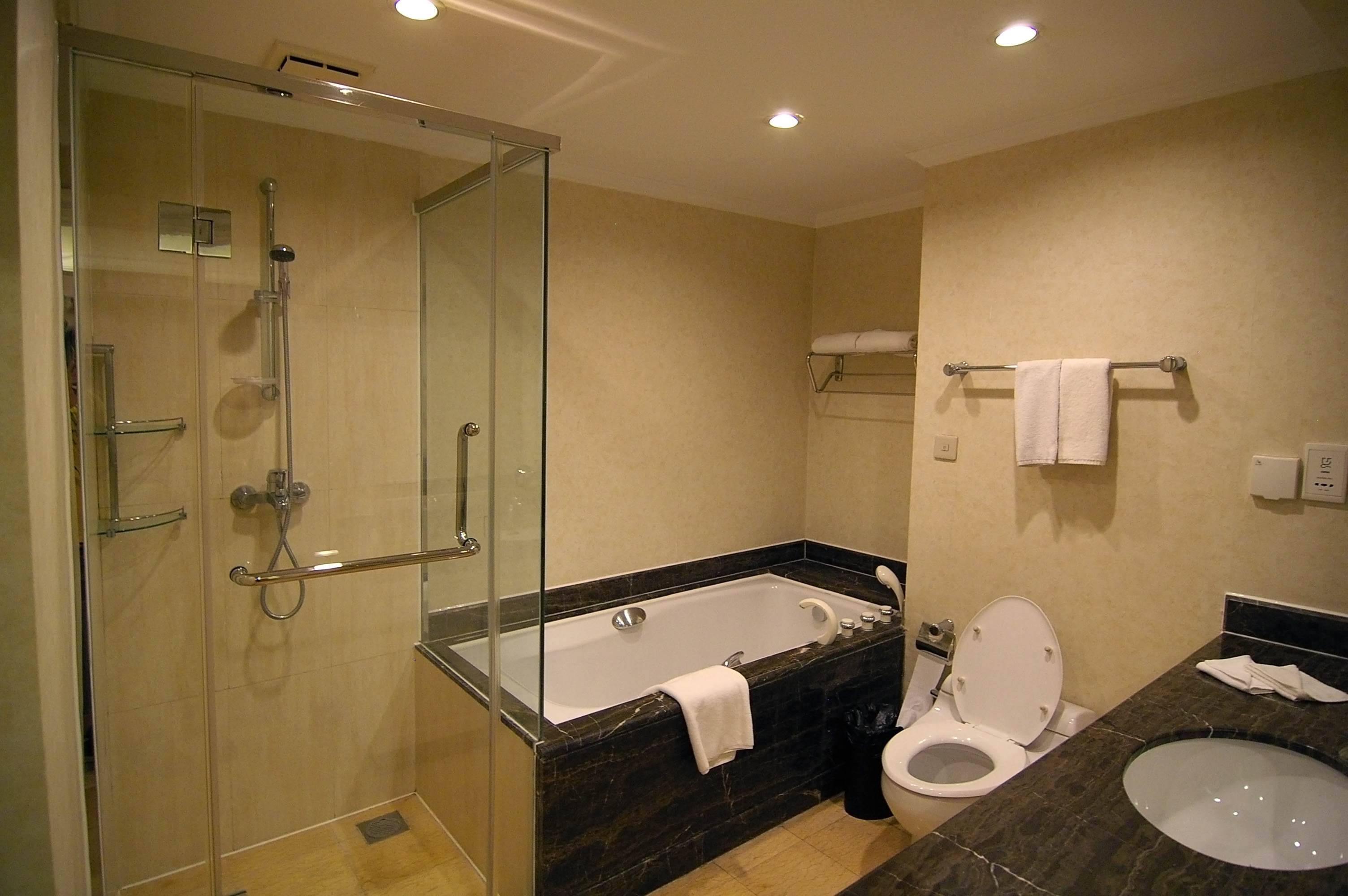 Clean Modern Bathroom With Shower And Bath Toilet And Wash Basin