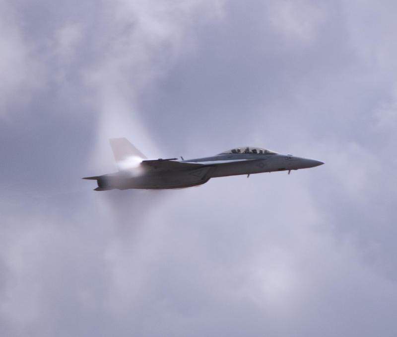 Transonic flight, a cloud of vapour formed as a  FA-18 Super Hornet breaks the sound barrier