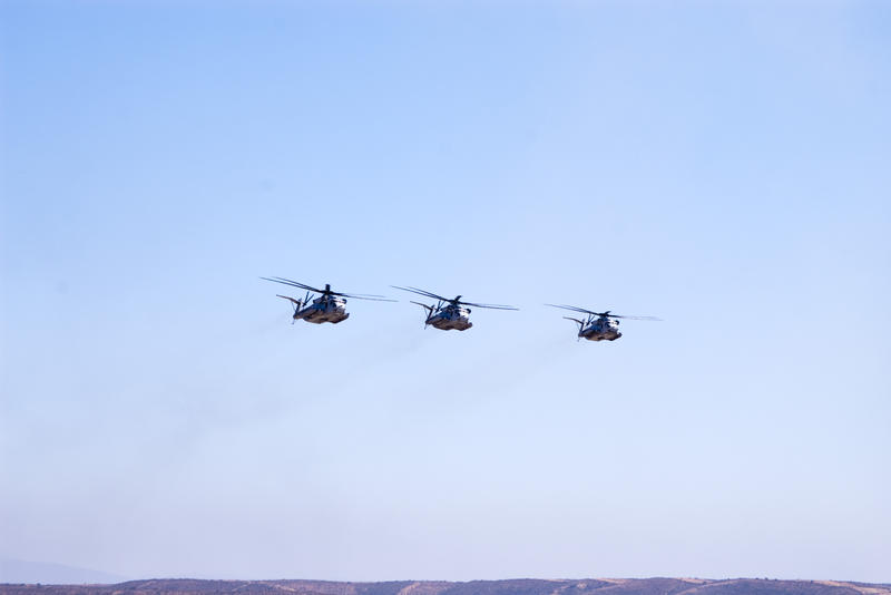 three heavily armoured CH-53e Super Stallion helicopters flying in formation