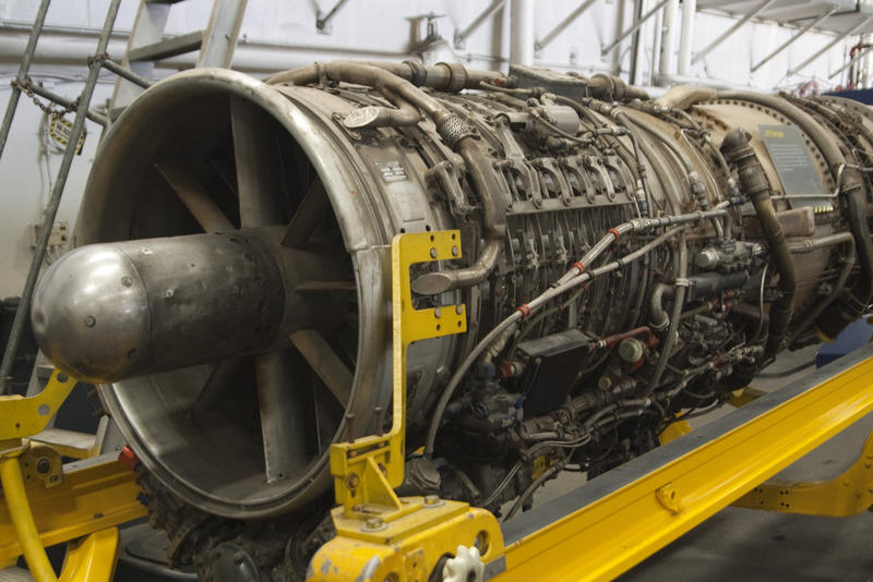 a jet engine with the cover removed revealing fuel and control lines
