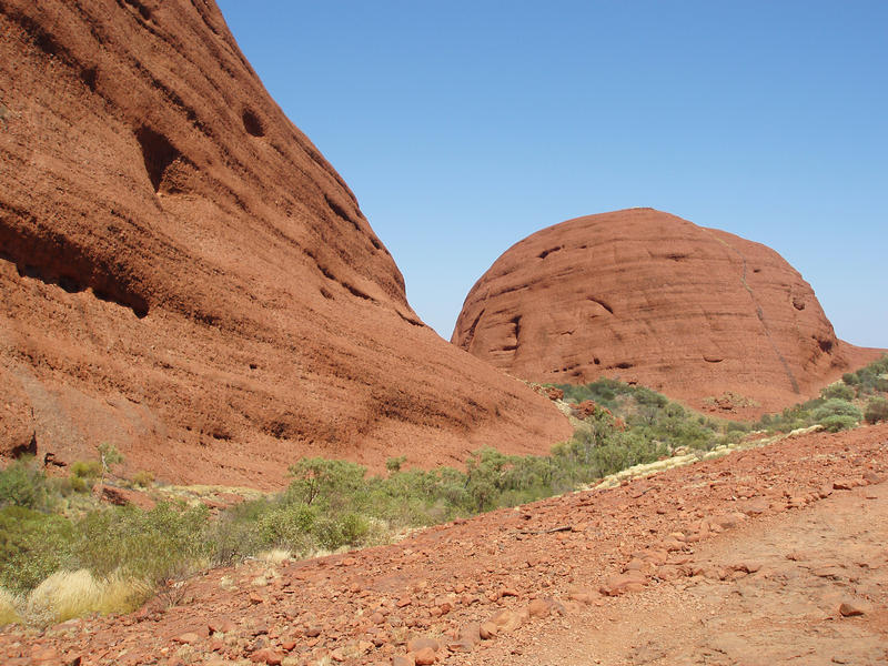 kata tjuta or the olgas, are a series or sandstone conglomorate formations in australias red centre