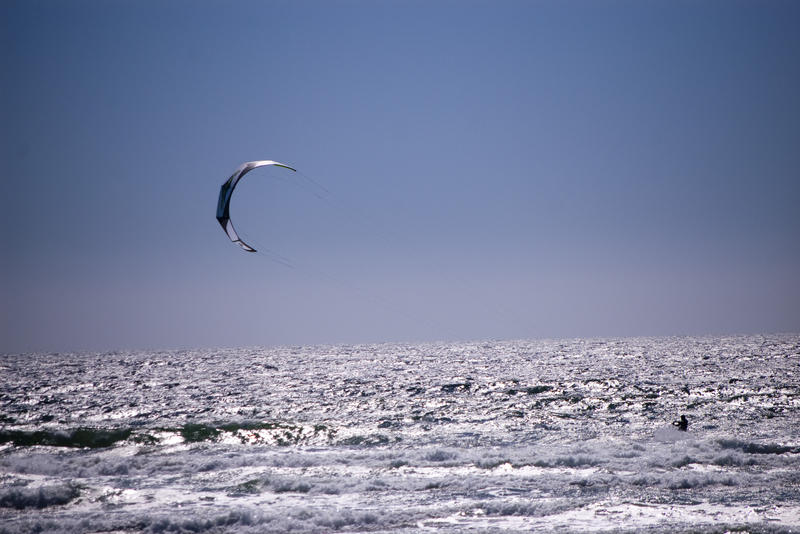 a kitesurfer riding along on the water