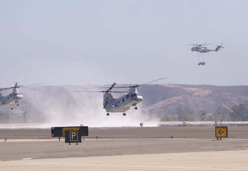 a chinook helicopter kicking up dust on landing