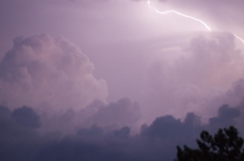 lighting flashes across clouds during a thunderstorm - blurred image