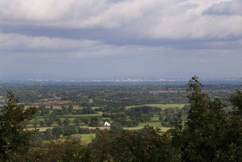 views of the city of manchester in the far distance from lyme park, cheshire