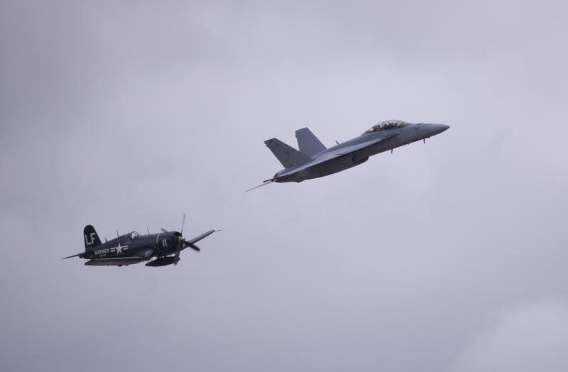 a navy F4U Corsair and an FA18 Hornet in flight