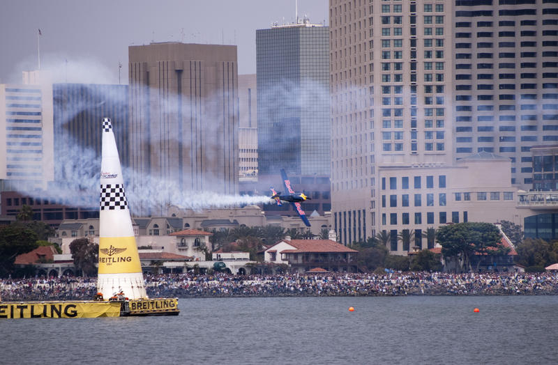 editorial use only : a plance flying through the finish gate at a red bull air race