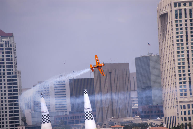 editorial use only : a plane flys through the finish gate at the san diego red bull air race
