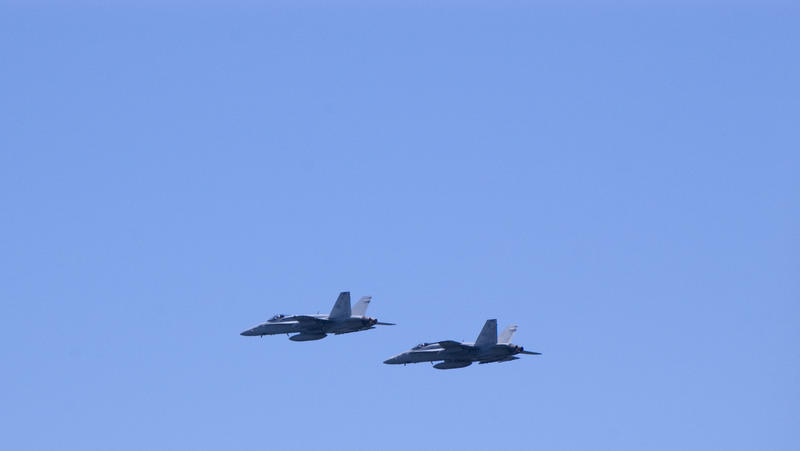 A pair of FA18 Super hornet aircraft flying against a blue sky