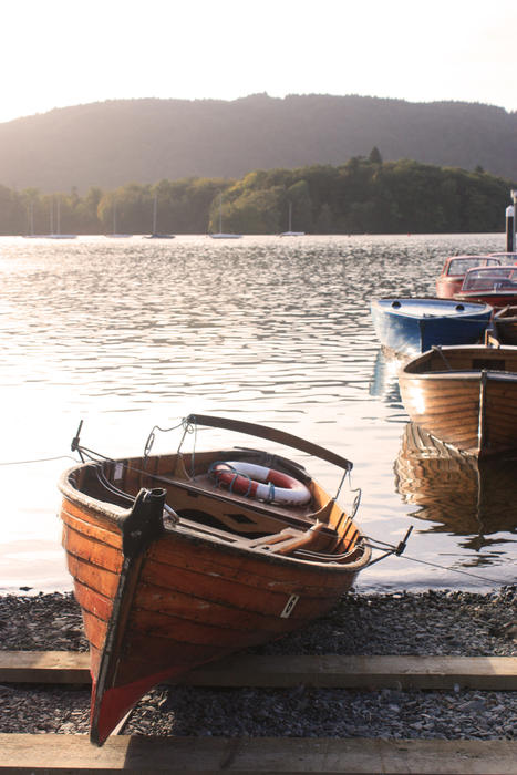 <p>Row Boat on the banks of Lake Windermere in the Lake District in Cumbria, UK</p>