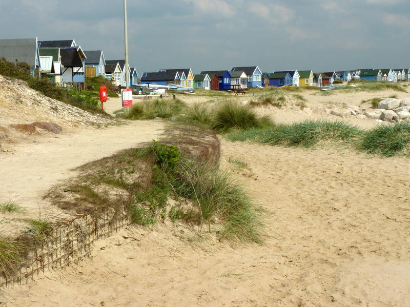 <p>Beach huts on Mudeford Spit at Hengisbury Head.jpg.</p>