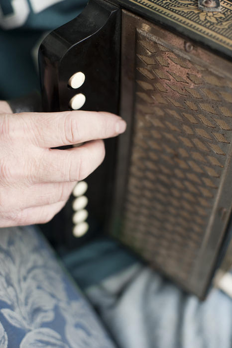 close up on a hand playnig the accordion