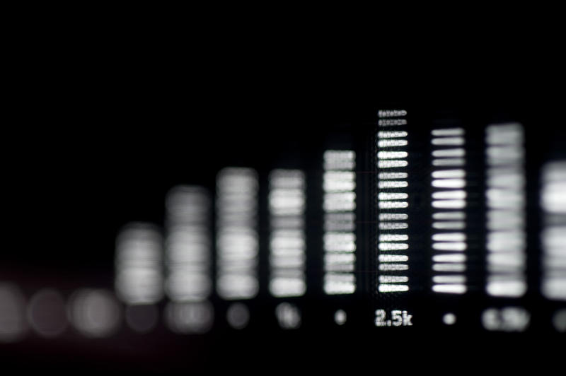 bar graphs on a spectrum analyser display pictured with a narrow depth of field