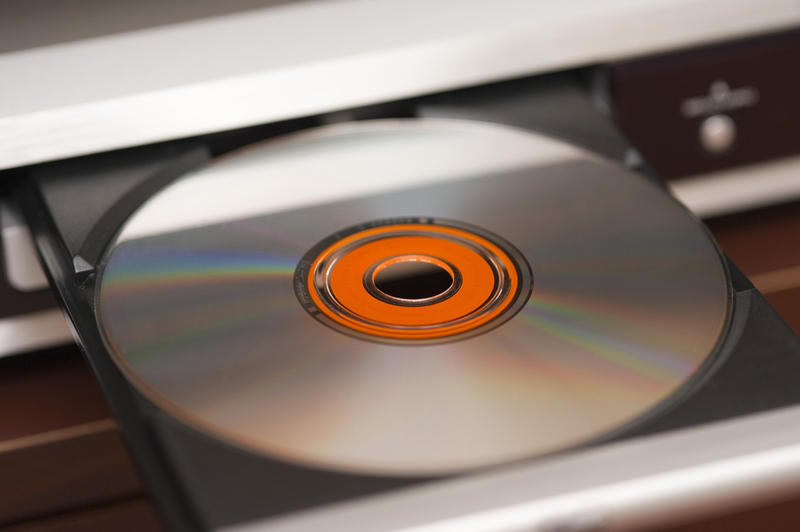 an audio CD in a sliding draw pictured with a narrow depth of field