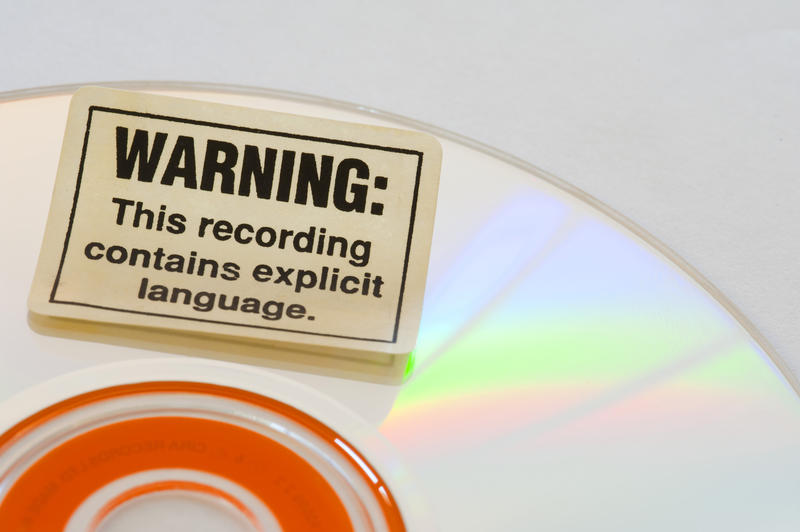 a explicit lyrics warning sticker on a CD