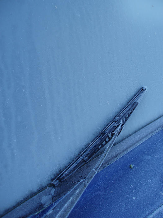 a common problem in cold climes, wipers frozen onto a car windscreen