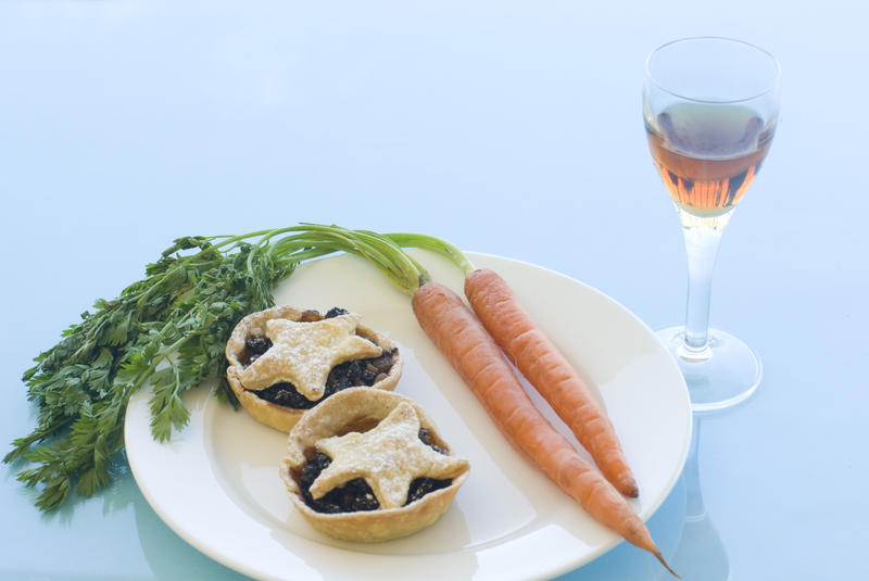a plate of christmas mince pies for santa and carrots of rudolph