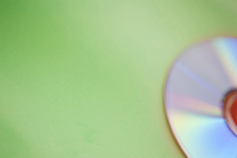 a defocused CD on a green background