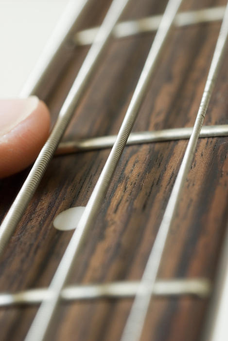 close up image of guitar strings taken with a narrow depth of field