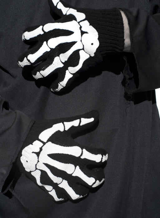 a pair of halloween costume hands, skeleton print gloves