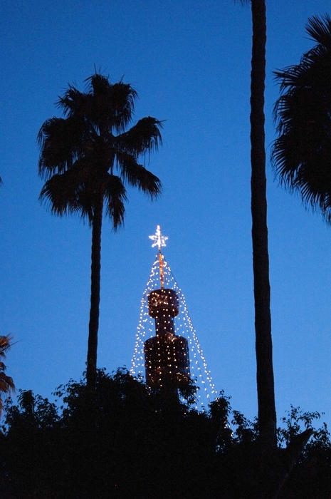 a tower decorated with streams of holiday lights