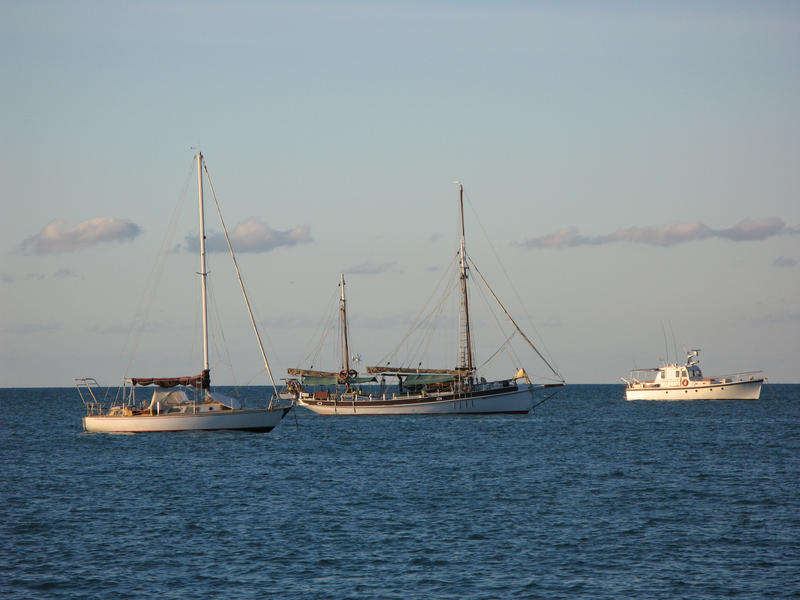 a ketch rigged sail boat on the water