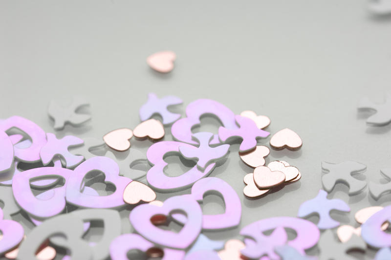 close up on pink heart shaped valentine decorative confetti with space for text