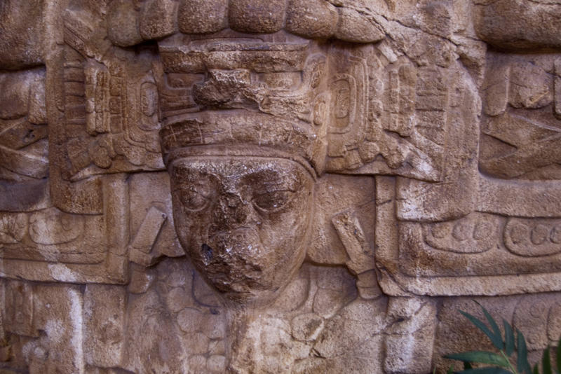mask of a face carved into stone