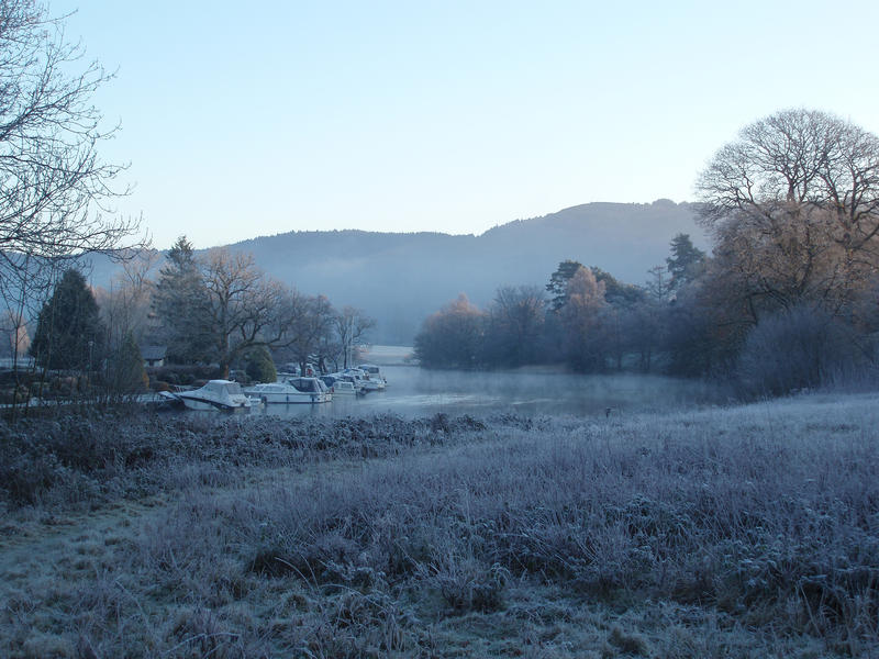 a view of lake windermere at newby bridge on a cold winter morning
