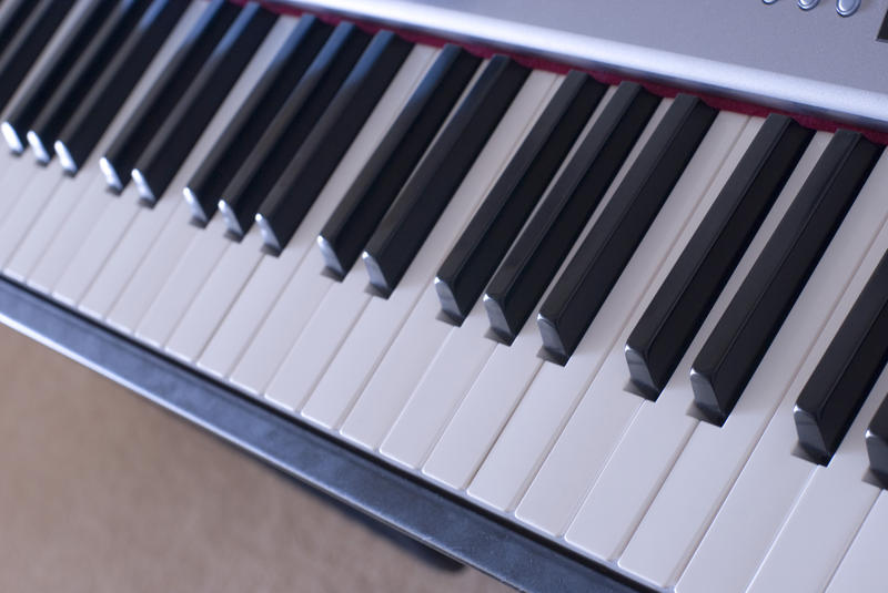 keys on a piano keyboard pictured at 45 degrees