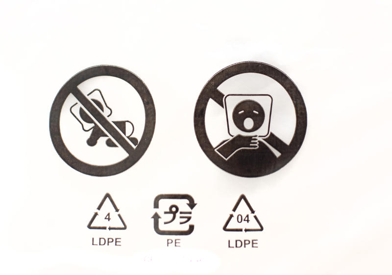 symbols on a plastic wrapper warning of suffocation